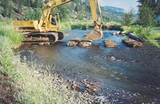 Environmental Monitoring - Large Backhoe Digger Crossing Stream