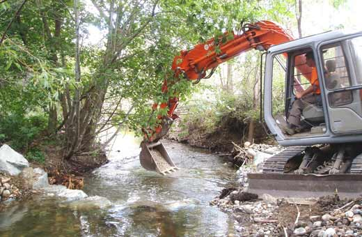Habitat Rehabilitation Of Environment - Backhoe Digging Stream