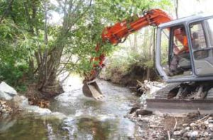 Natures Habitat Rehabilitation - Backhoe Digger In Creek